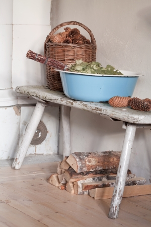 kindling:  preparing for sauna  - still life with enamelled tub, sauna besom, kindling and firewood