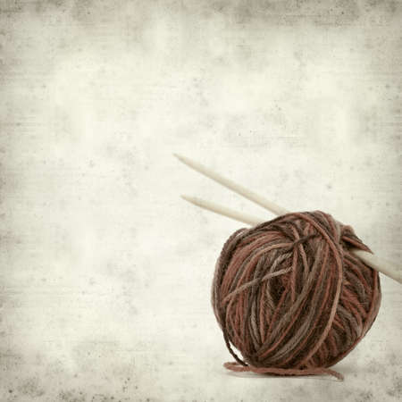textured old paper background with knitting yarn photo