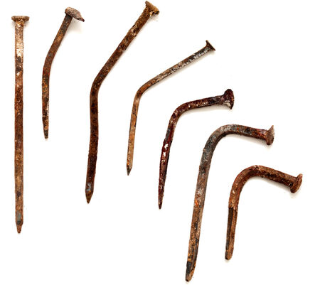 progressively: a sequence of progressively more bent forge nails