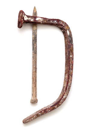 majuscule: forged nails letters - old rusty bent nails in shape of letters, isolated on white