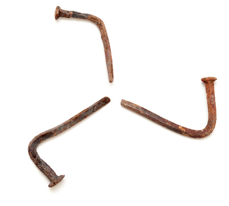 forged nails letters - old rusty bent nails, three-legged runner figure