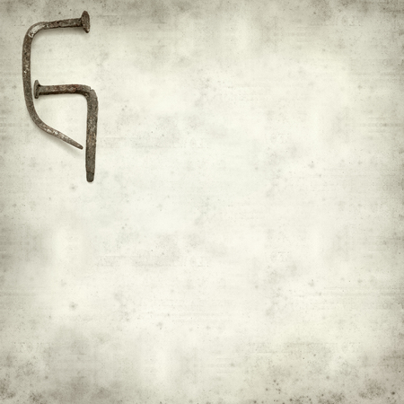 g spot: textured old paper with rusty nails letter Stock Photo