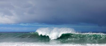 breaking off: Breaking waves off north west coast of Cran Canaria, outline of Tenerife in the background