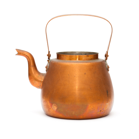 vintage copper kettle isolated on white background photo