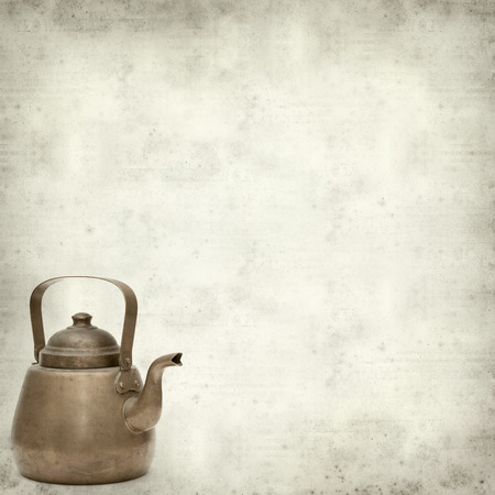textured old paper background with vintage copper kettle photo