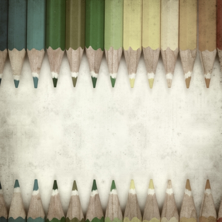 textured old paper background with color pencils photo