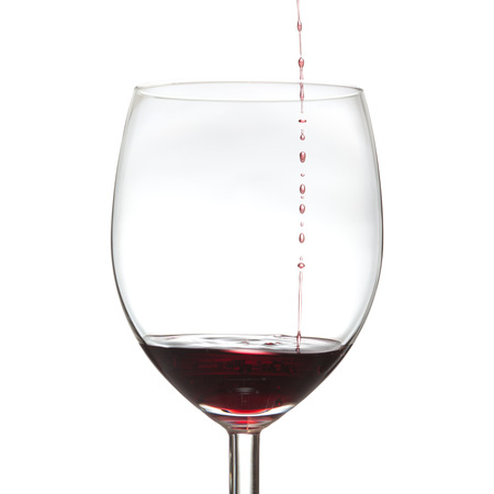 just a little drop - red wine drops falling into a glass photo