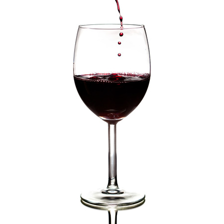 pouring red wine isolated on white background - last drops photo