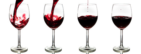 pouring red wine isolated on white background - stages photo