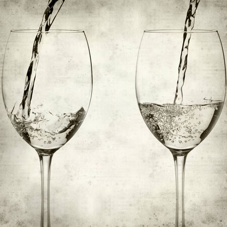 textured old paper background with pouring white wine photo