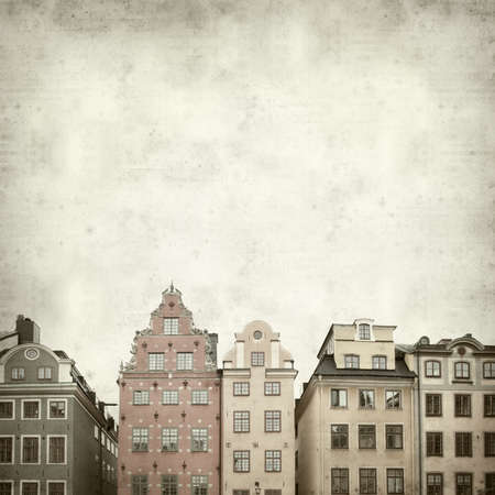 textured old paper background with Stockholm facades photo