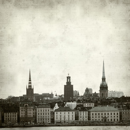 textured old paper background with Stockholm old town skyline photo