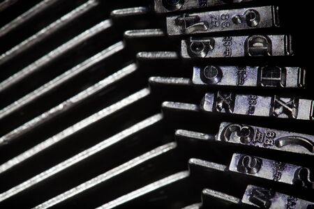 old typewriter type bars, mechnical background photo
