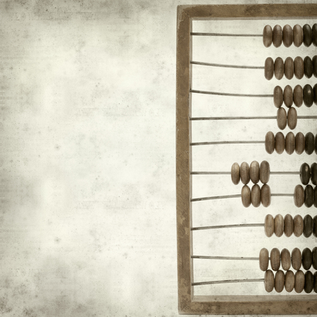 textured old paper background with wooden abacus photo