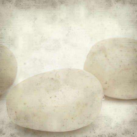 calorific: textured old paper background with new potatoes