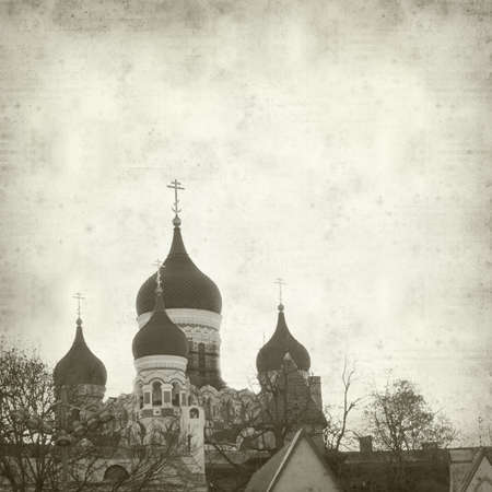 tallin: textured old paper background with Tallin rooftops