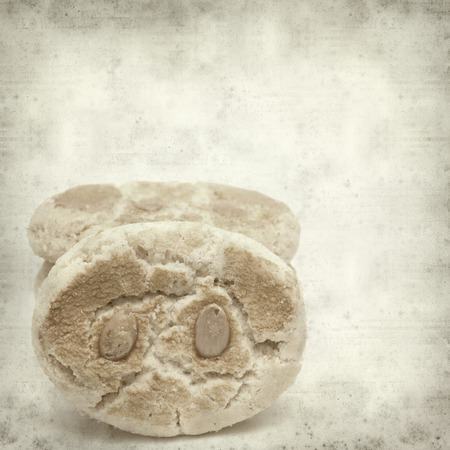 textured old paper background with traditional canarian almond bisquits photo