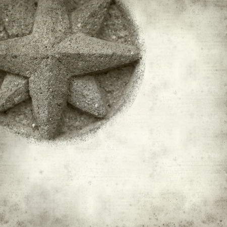 textured old paper background with compass stone relief