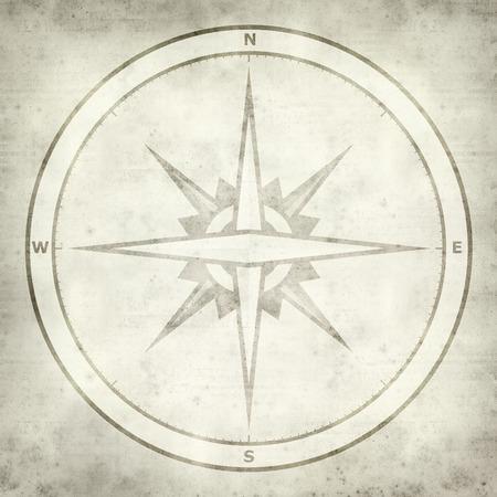 texturé vieux fond de papier avec le symbole de la boussole