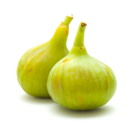 calorie rich food: white figs isolated on white background