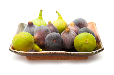 black and white figs on a ceramic plate isolated on white photo