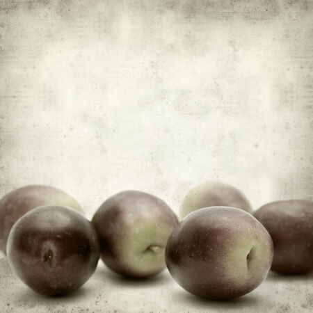 textured old paper background with fresh olives photo