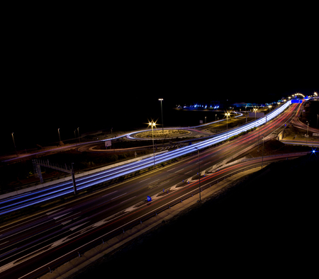 motorway junction at night, black copyspace above photo