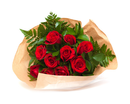 bunch of red roses in florist wrapping isolated on white photo