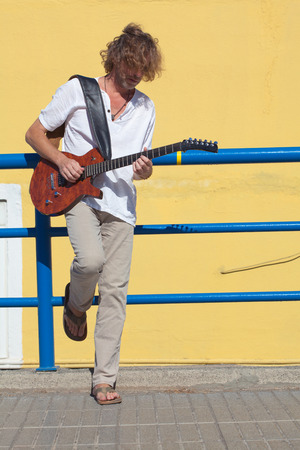 busker: travelling with music - busker with a guitar