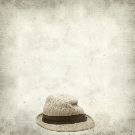 misshapen: textured old paper background with old broken panama straw hat Stock Photo