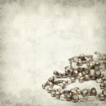 freshwater pearl: textured old paper background with strings of freshwater pearls