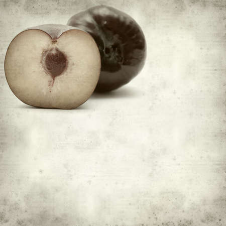 textured old paper background with large red plums photo