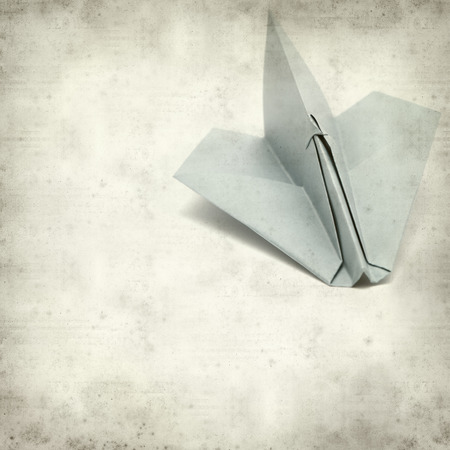 textured old paper background with paper plane photo