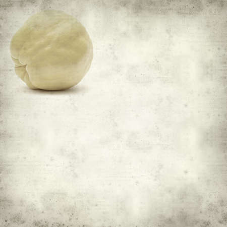 textured old paper background with yellow ripe quince fruit photo