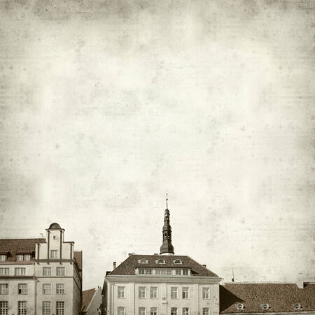 textured old paper background with Tallinn architecture photo