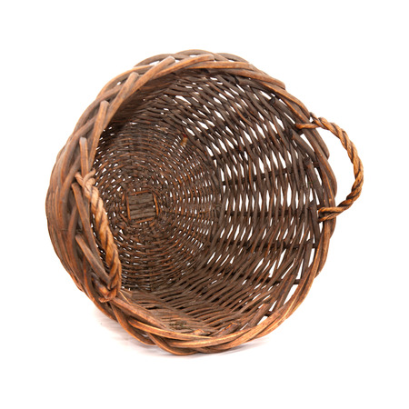 large empty basket for harvesting fruit or grapes isolated on white photo