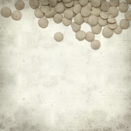 textured old paper background with lentils photo