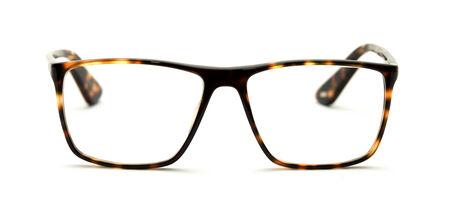 reading glasses with tortoiseshell frames isolated on white photo