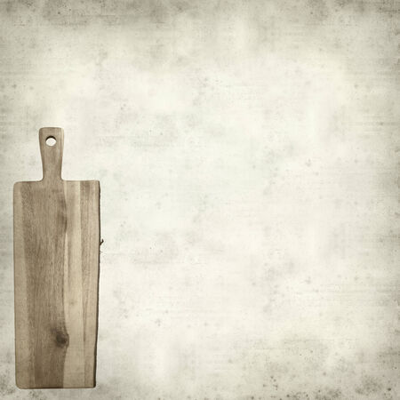 trivet: textured old paper background with wooden chopping board
