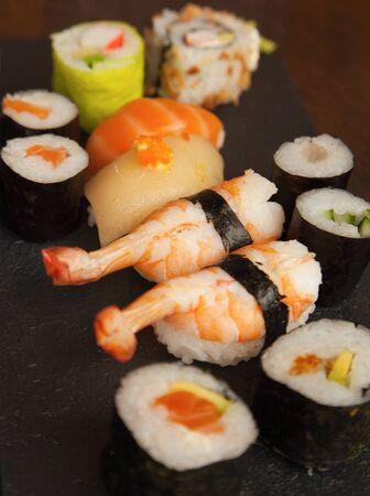 trivet: a set of sushi rolls on black trivet