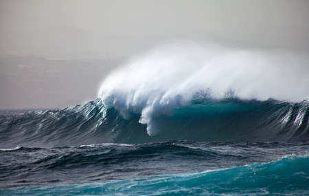 ocean waves breaking by the shores of Gran Canaria photo