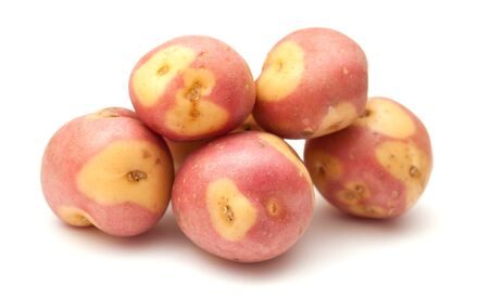 Canary islands potatoes, pink variety, isolated on whie background photo
