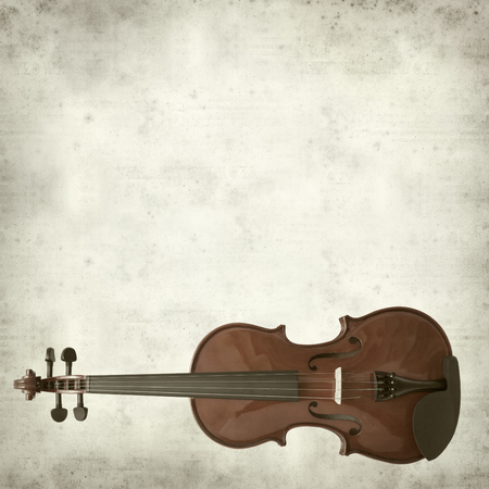 textured old paper background with violin photo