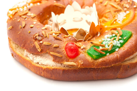 man nuts: Traditional ring-shaped cake Roscon del Reyes isolated on white  Stock Photo