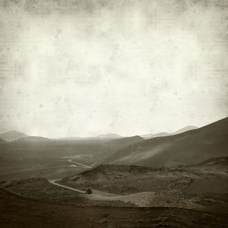 timanfaya: textured old paper background with landscape of Timanfaya volcano par on Lanzarote Stock Photo