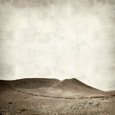 textured old paper background with extinct volcano Bayuyo on Fuerteventura photo