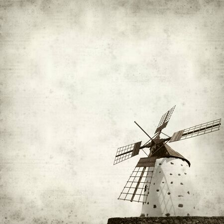 textured old paper background with traditional round windmill, molino, of Fuerteventura photo