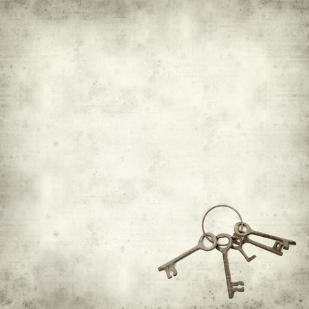 textured old paper background with old keys photo