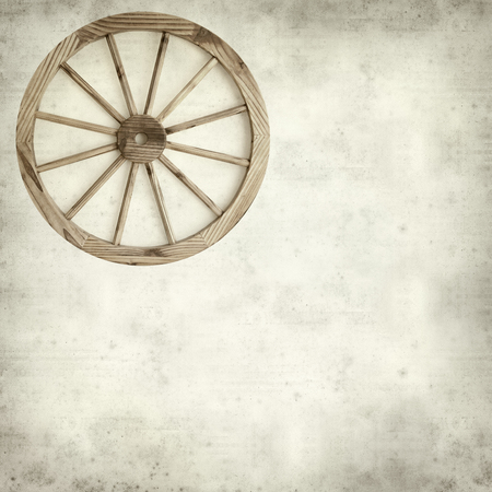 textured old paper background with old wagon wheel photo