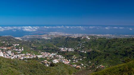 las palmas: Gran Canaria, view over historic town Teror to Las Palmas in far distance, aerial view panorama Stock Photo